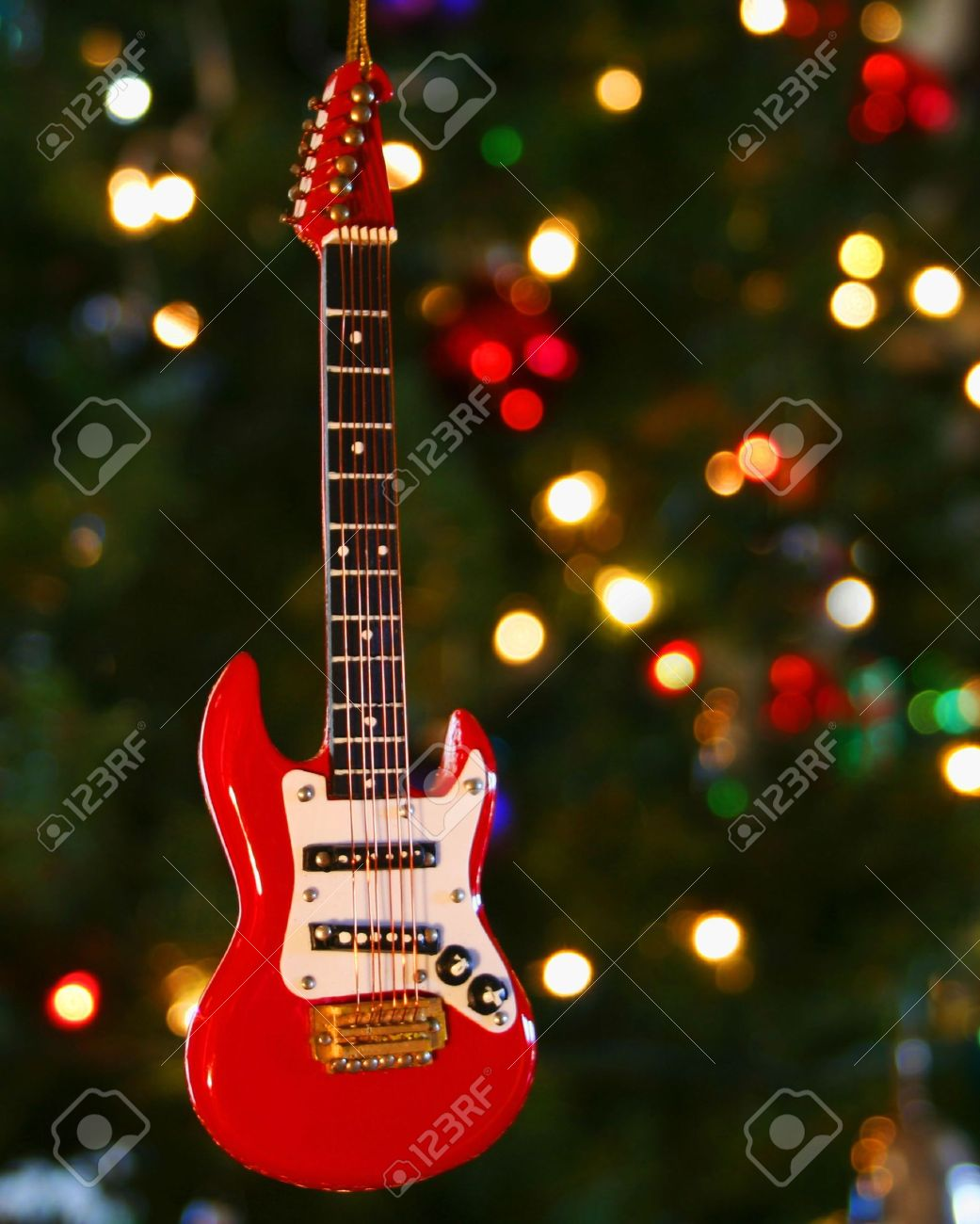 A Red Electric Guitar Ornament And Lights On A Christmas Tree Stock ...