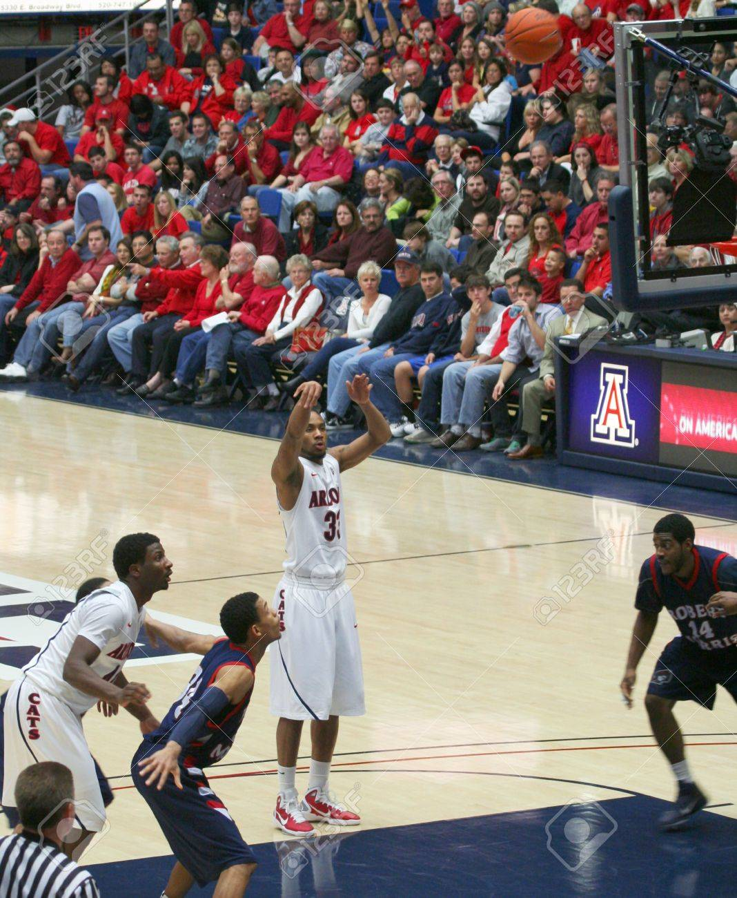 A Foul Shot by Jesse Perry in a University of Arizona Wildcats Men's Basketball Game Against the Robert Morris Colonials at McKale Center, Tucson, on December 22, 2010. Also Solomon Hill, Russell Johnson, Gary Wallace. Stock Photo - 8533051