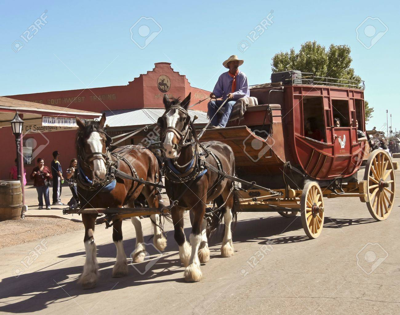 Tombstone, Arizona - October 22: Allen Street on October 22, 2011, in Tombstone, Arizona. A Helldorado stagecoach welcomes tourists to historic Allen Street where gunfights and barroom brawls are staged during this annual celebration of the Old West. Stock Photo - 10977210