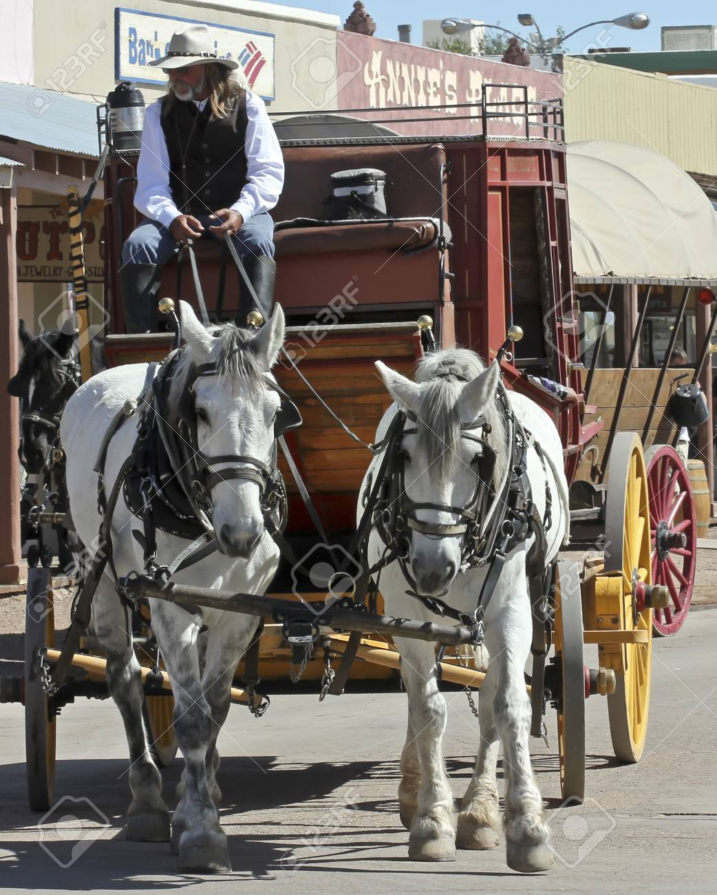 Tombstone, Arizona - October 22: Allen Street on October 22, 2011, in Tombstone, Arizona. A Helldorado stagecoach welcomes tourists to historic Allen Street where gunfights and barroom brawls are staged during this annual celebration of the Old West. Stock Photo - 11013649