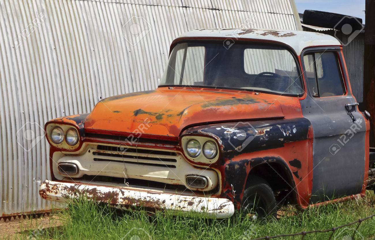An Old Abandoned Pickup Truck Sits In A Junkyard. Stock Photo ...
