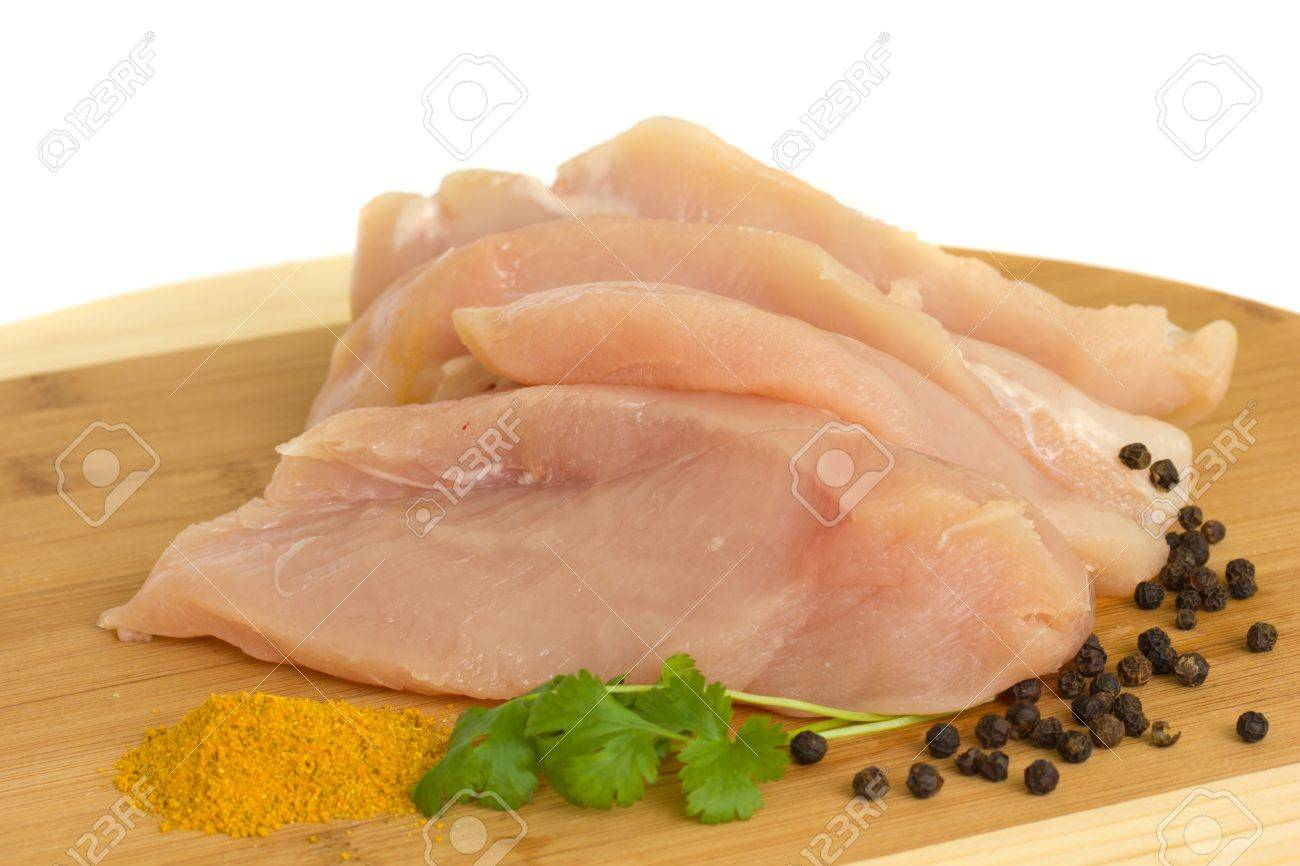 raw chicken breast meat with spices isolated on white Stock Photo - 11259188