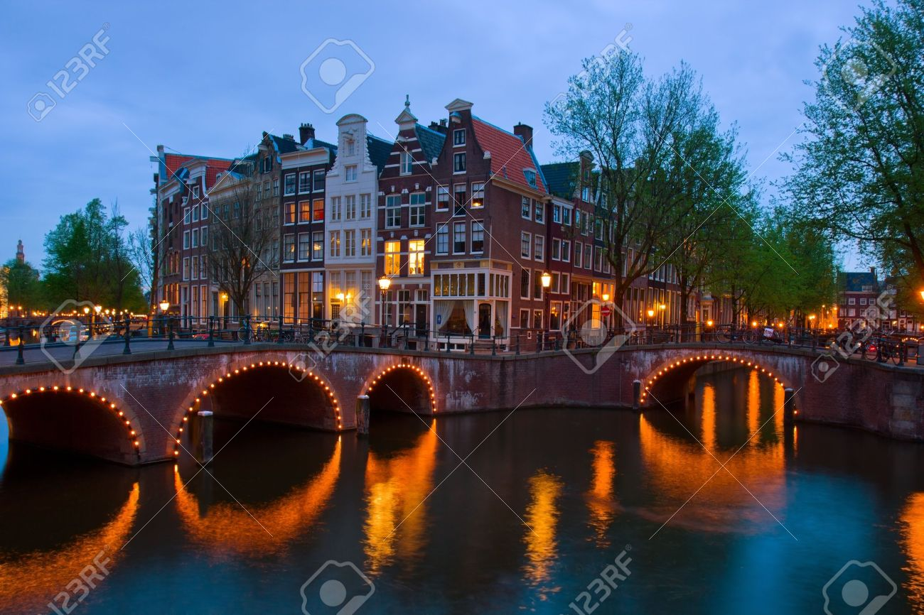 famous canals of Amsterdam, the Netherlands at duskmous canals of Amsterdam, the Netherlands at dusk Stock Photo - 13797420