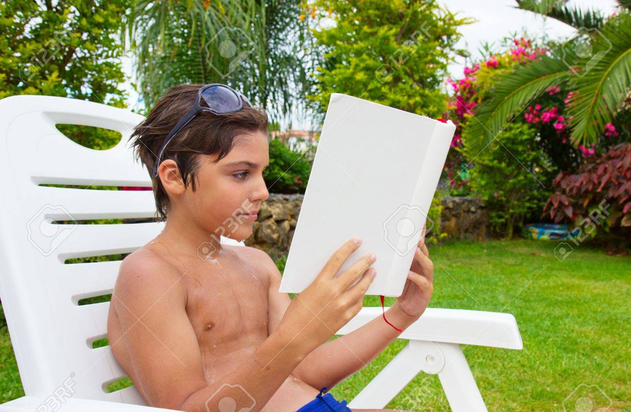 Handsome Boy Reading Book Near Pool Lawn Stock Photo, Picture And ...