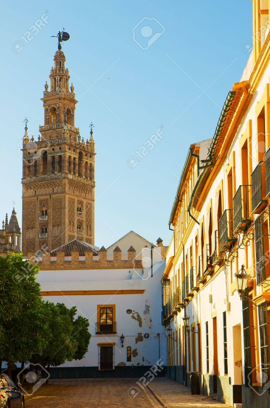 Bell Tower Of Cathedral Church Over Patio De Las Banderas Seville