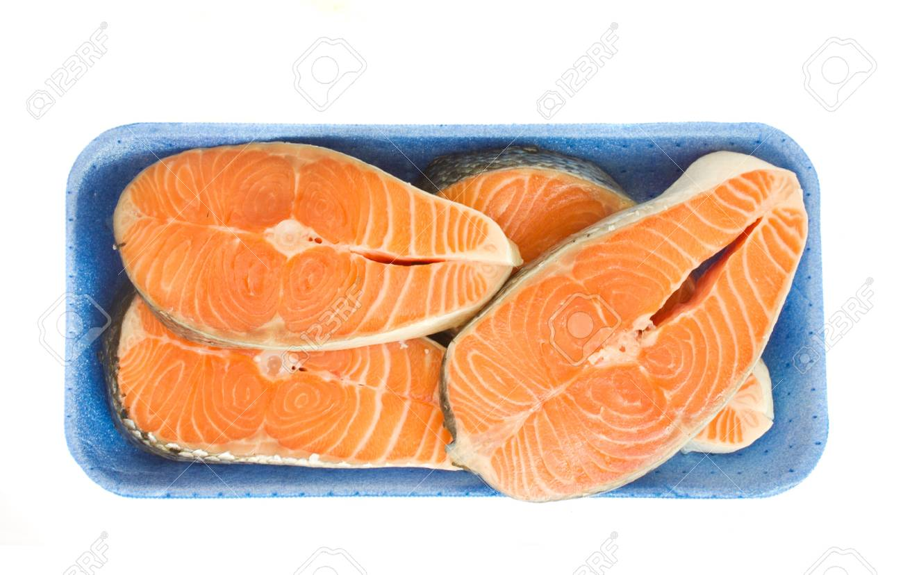 raw salmon steaks in tray  isolated on white background Stock Photo - 15170665