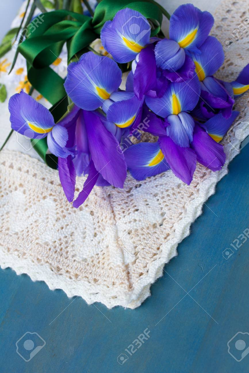 Bouquet of iris flowers laying on blue table stock photo picture bouquet of iris flowers laying on blue table stock photo 17580417 izmirmasajfo Image collections