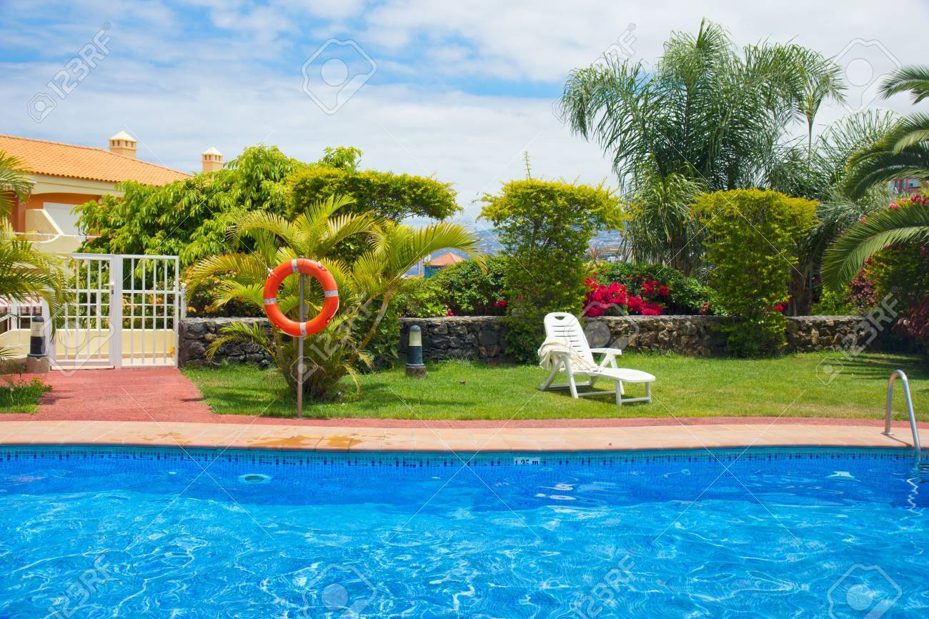 Blue Swimming Pool In Exotic Tropical Garden Stock Photo Picture And Royalty Free Image Image 18387000