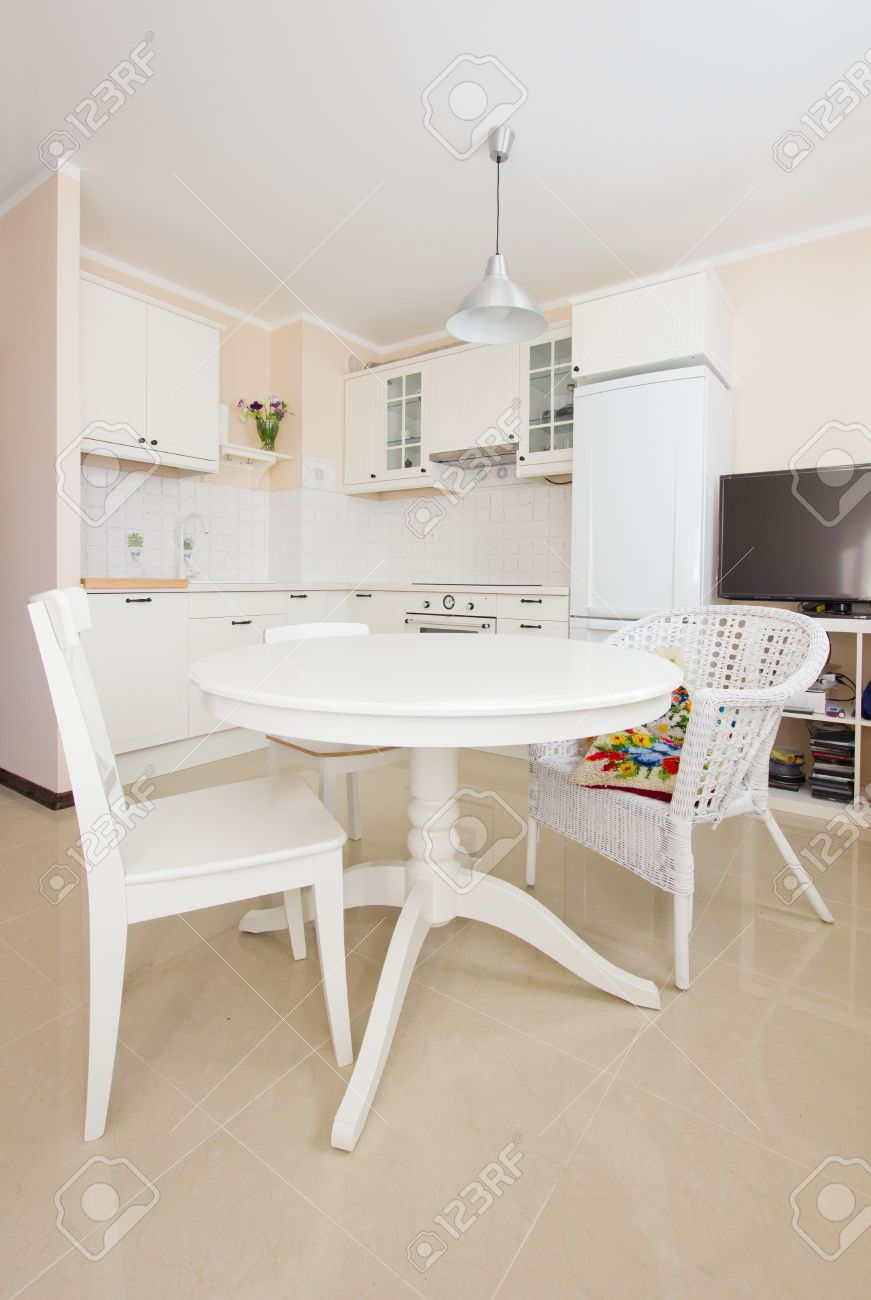 Empty Modern White Kitchen With Dining Table In Antique Rustique Style Stock Photo