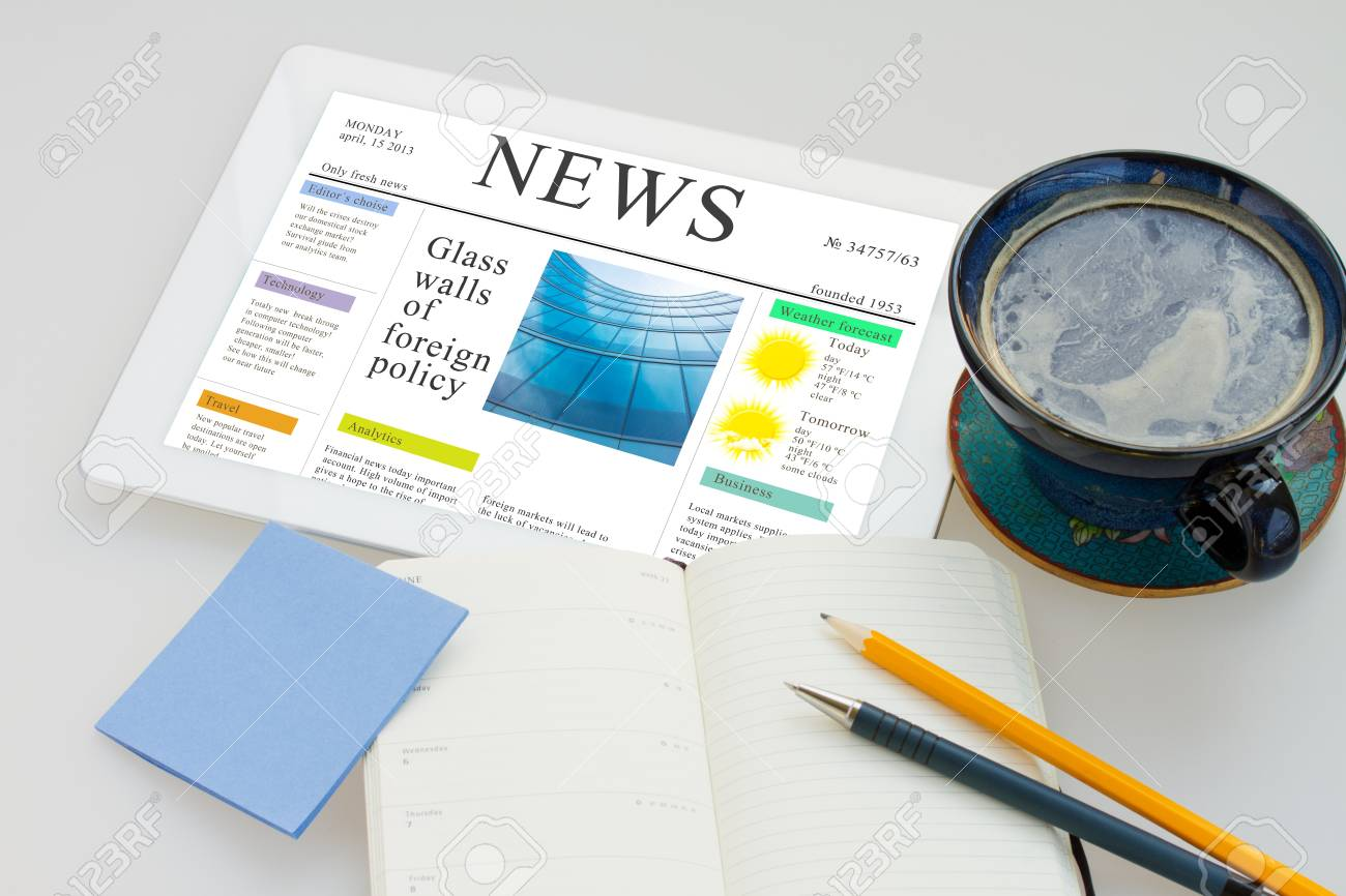 tablet pc with news site and  cup of coffee Stock Photo - 19316951