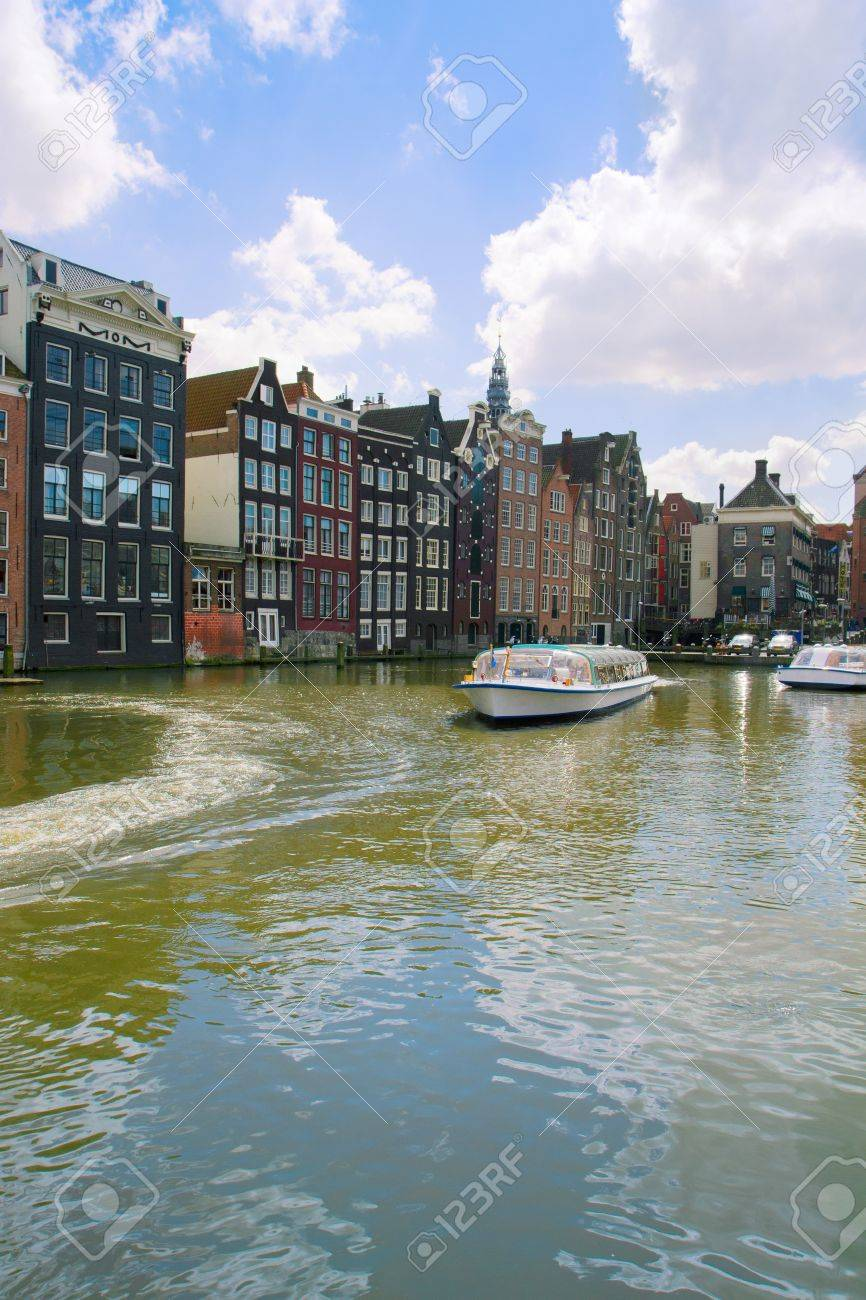 medieval houses and ships over water in Amsterdam, Netherlands Stock Photo - 20468592