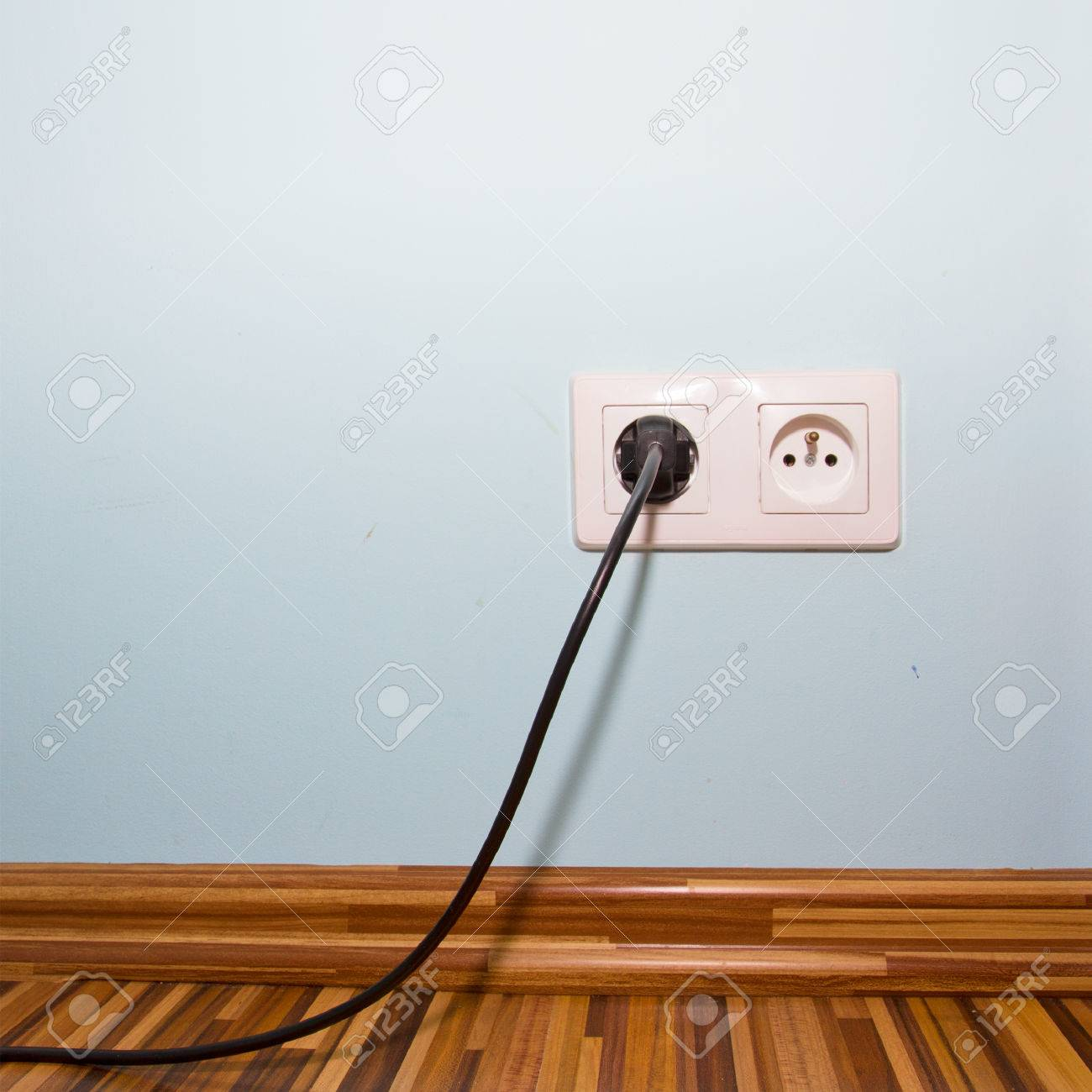 Blue Room Wall With Electric Socket And Plug Stock Photo, Picture ...