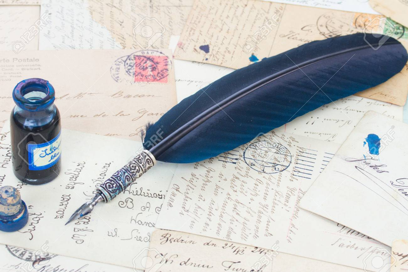 8707837e634a1 blue feather pen and inkwell on old papers and letter background