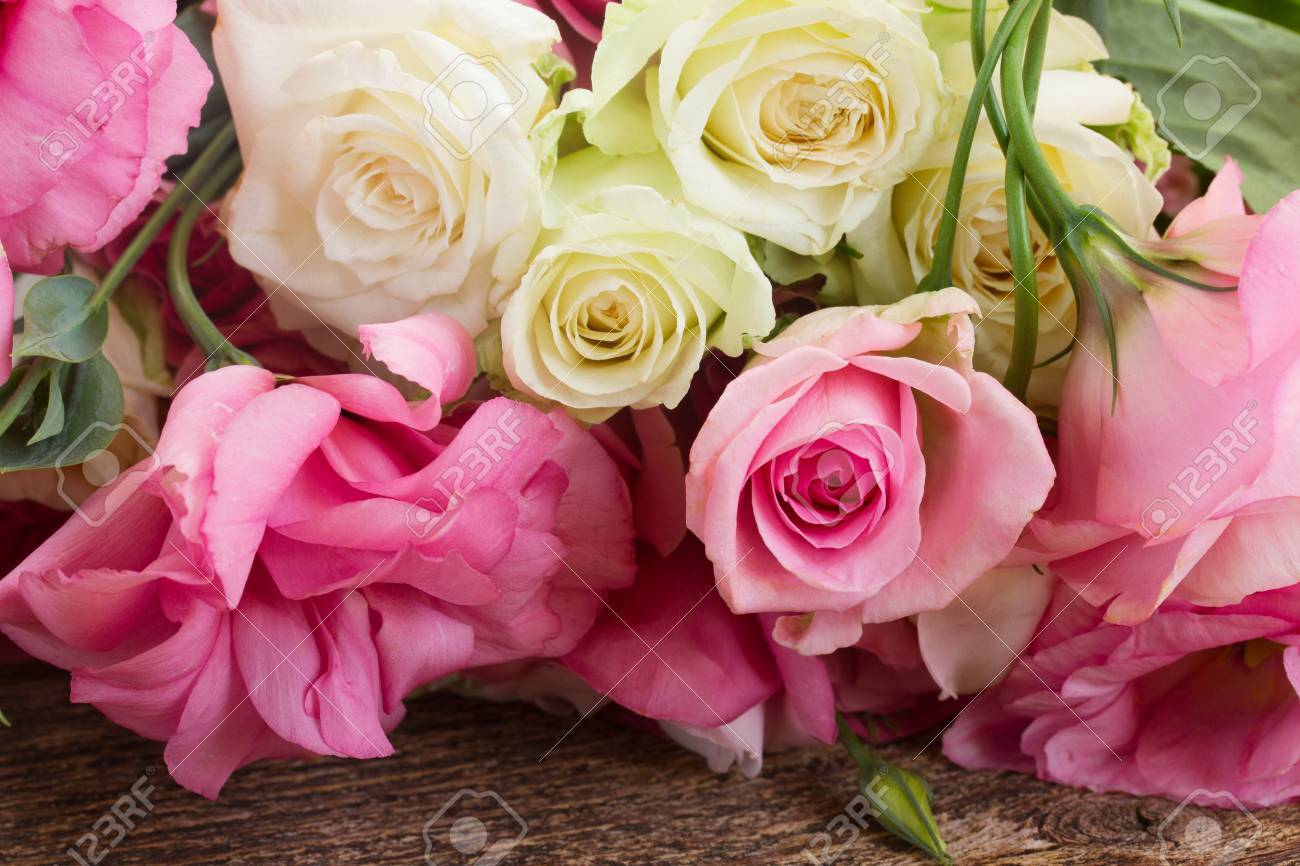 Pink And White Fresh Roses And Eustoma Flowers Close Up Stock Photo