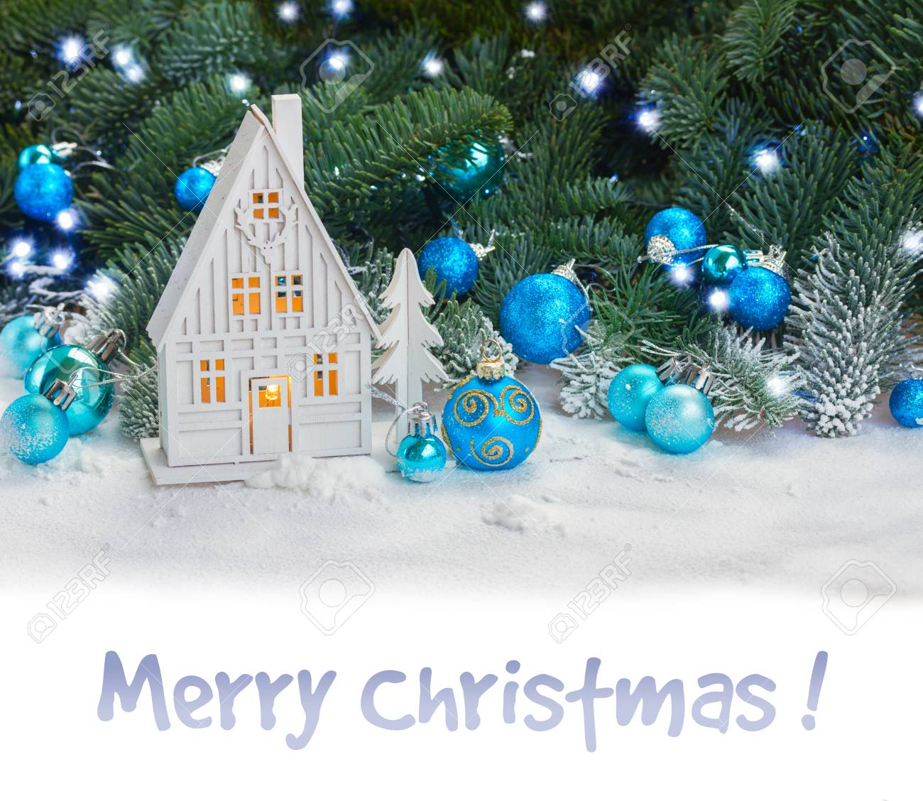 White christmas house with blue decorations in snow border on white and sample text Merry Christmas - 49233685
