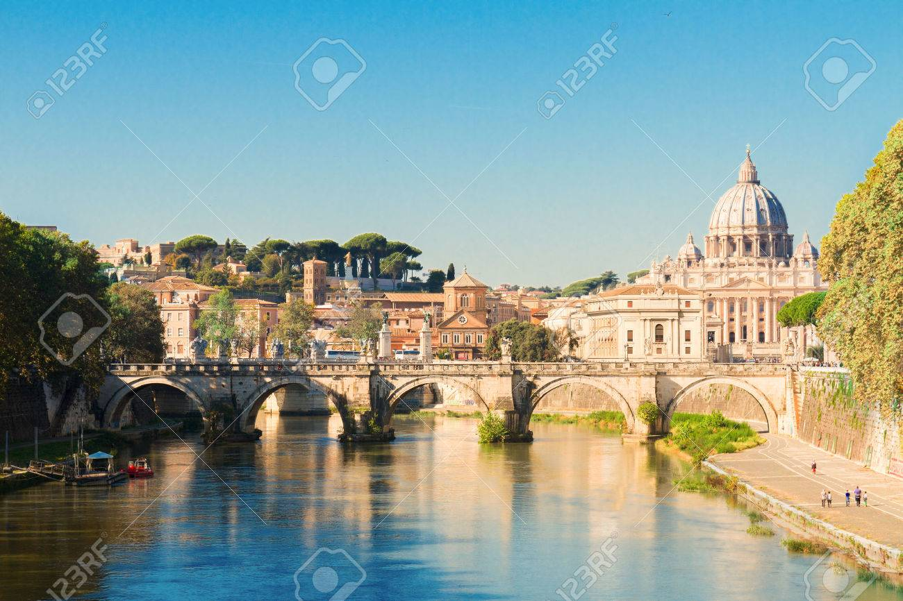 St. Peter's cathedral over bridge and river in Rome, Italy - 50431058