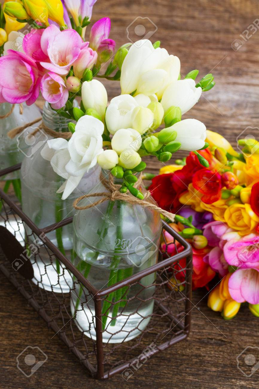 Fresh freesia flowers in vases close up on wooden table background fresh freesia flowers in vases close up on wooden table background stock photo 54627318 reviewsmspy