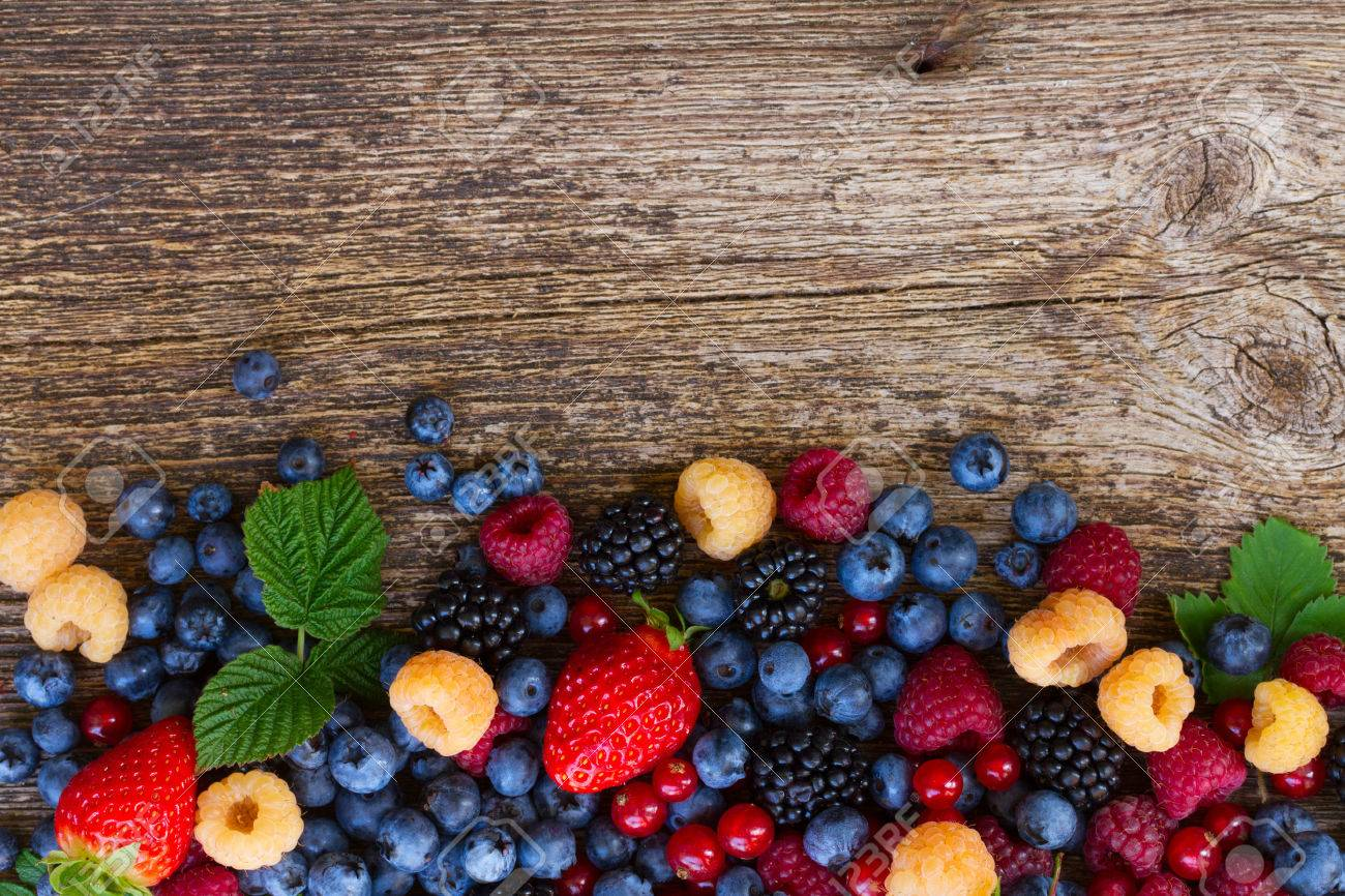 pile of fresh berries mix on wood, top view - 54627408