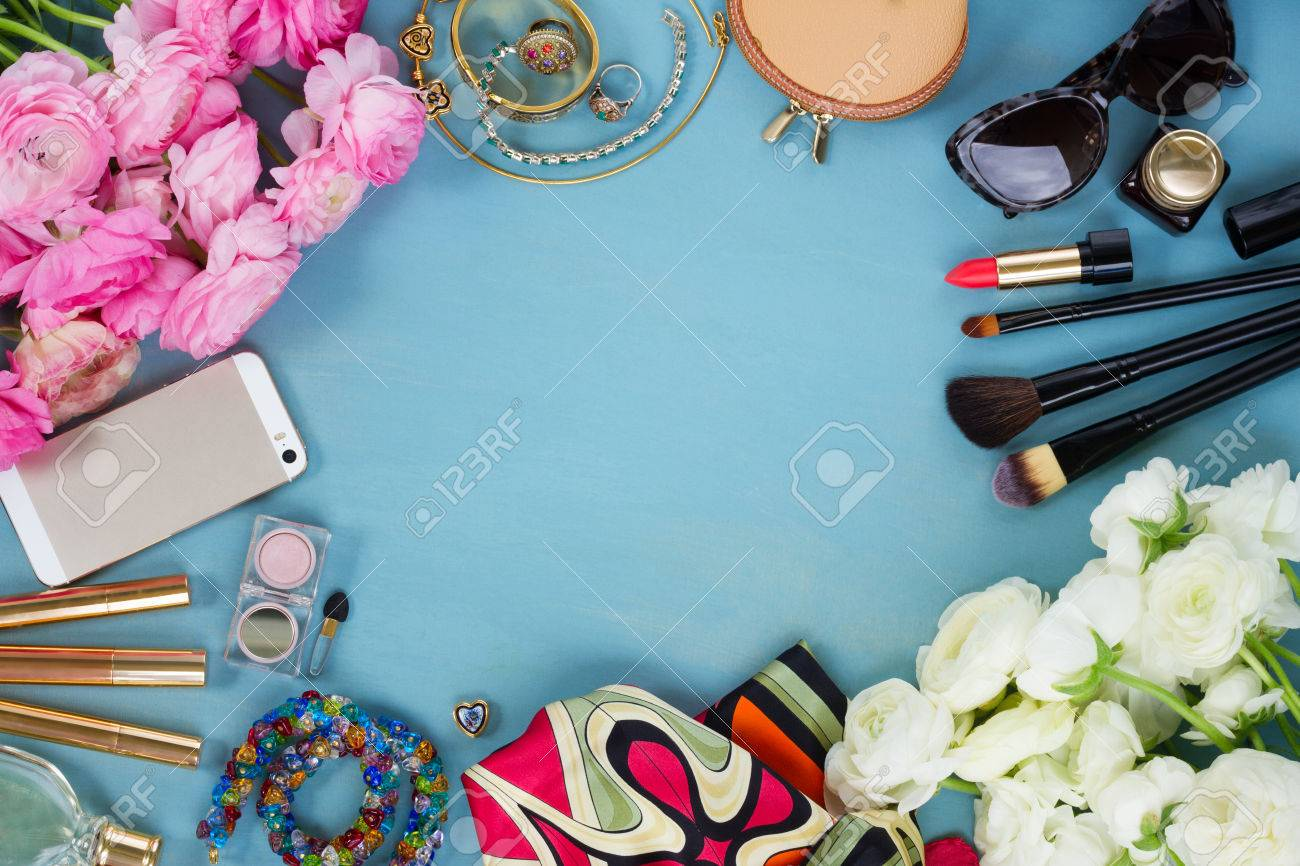 woman fashion flat lay items and fresh flowers on blue wooden background, copy space, top view - 60783906