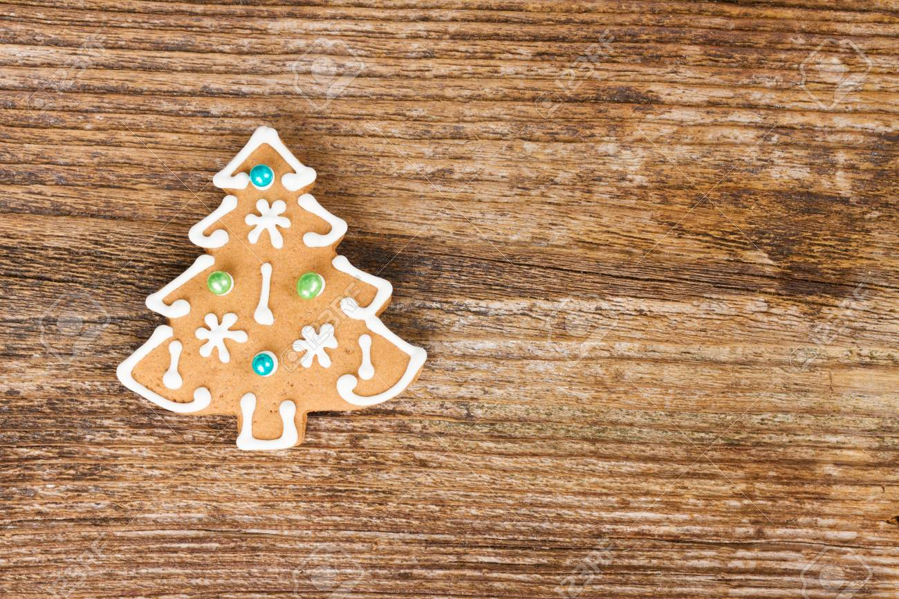 Gingerbread Christmas Tree Cookies On Wooden Background