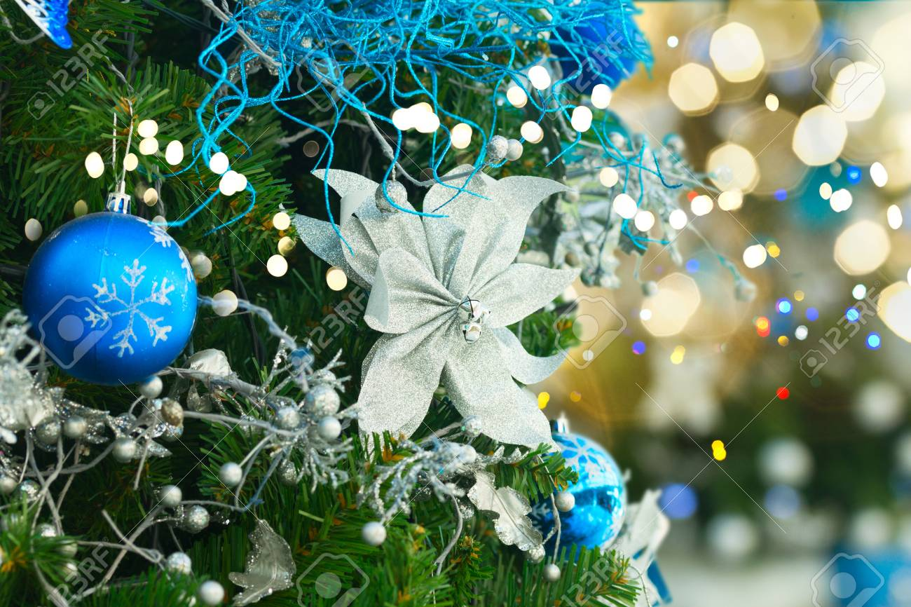 Christmas Tree With Holiday Blue And White Decorations And Lights