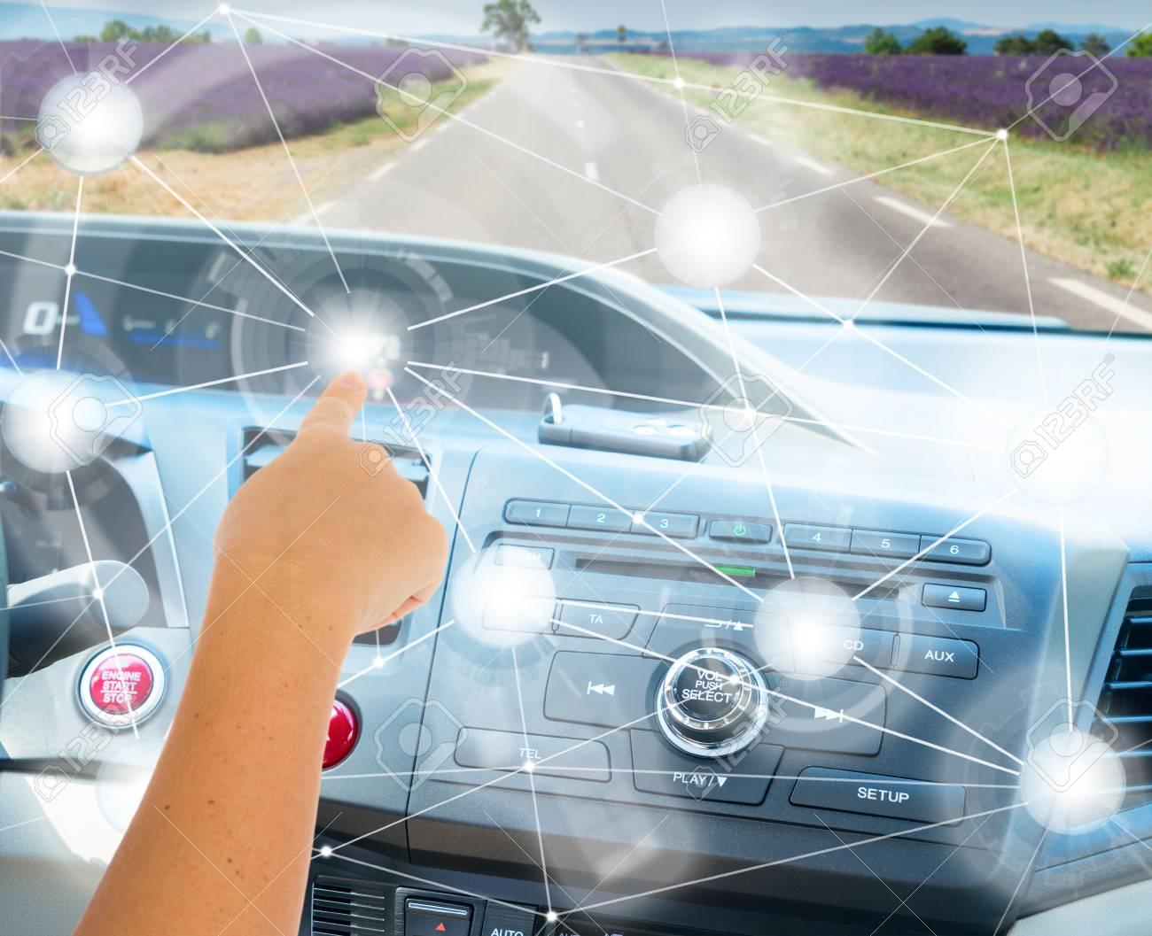 Self-driving car concept - someones hand programming modern car - 65114674