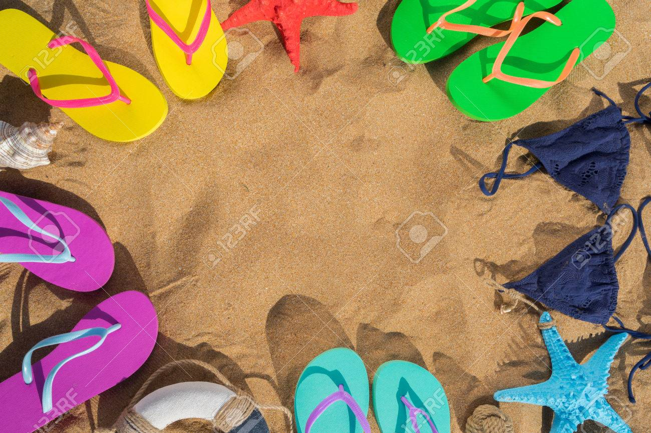 Summer Beach Fun - Frame On Sand With Sandals And Swimming Suits ...