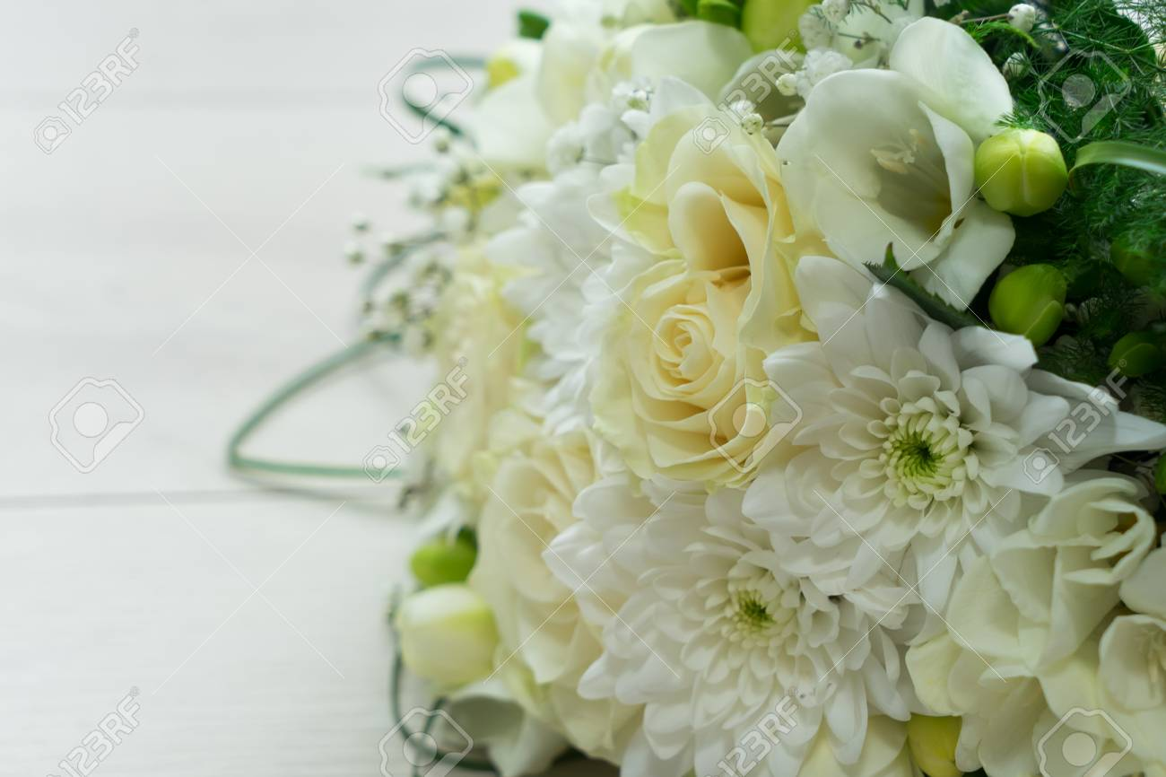White Fresh Roses Freesia And Mum Flowers Bouquet Close Up Stock