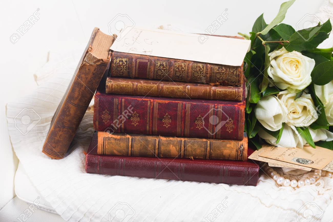Old Vintge Books With White Fresh Flowers On Romantic Lace