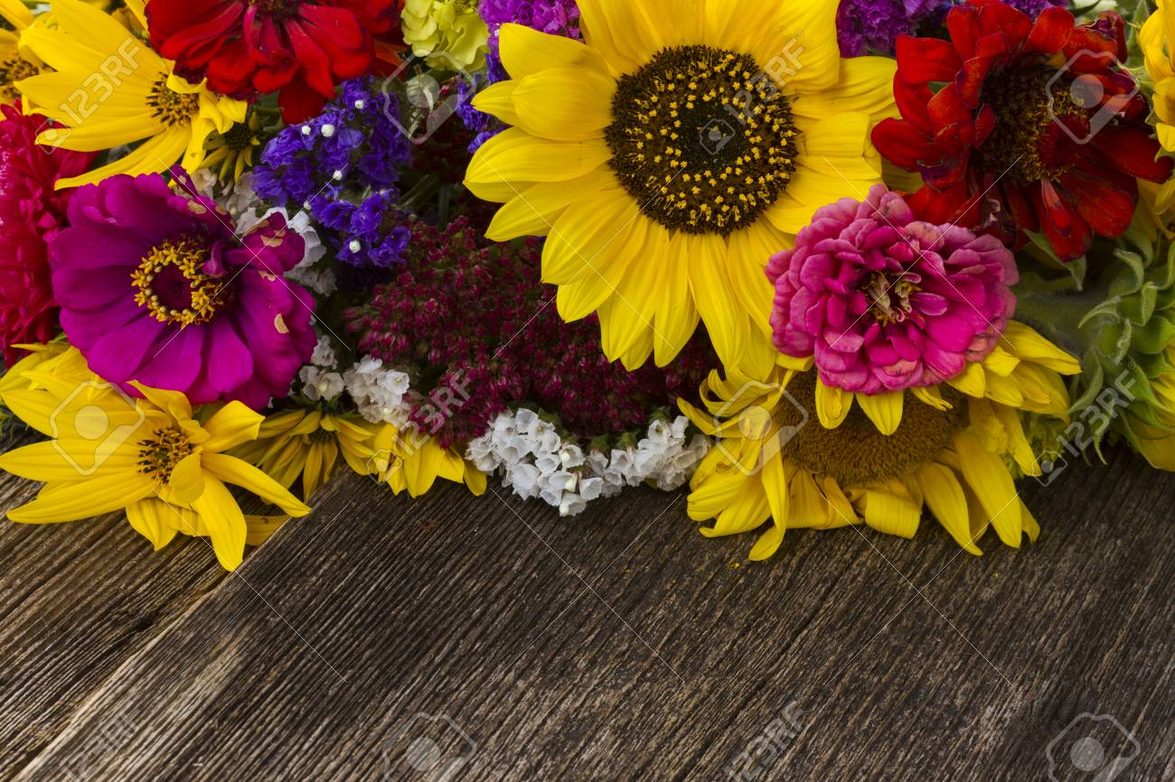 Bright Bouquet With Fresh Fall Flowers On Wooden Table Close Stock Photo Picture And Royalty Free Image Image 83159739