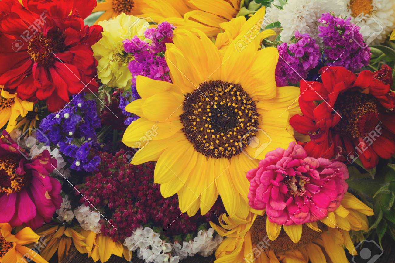 Bright bouquet with fresh fall flowers close up background, retro..
