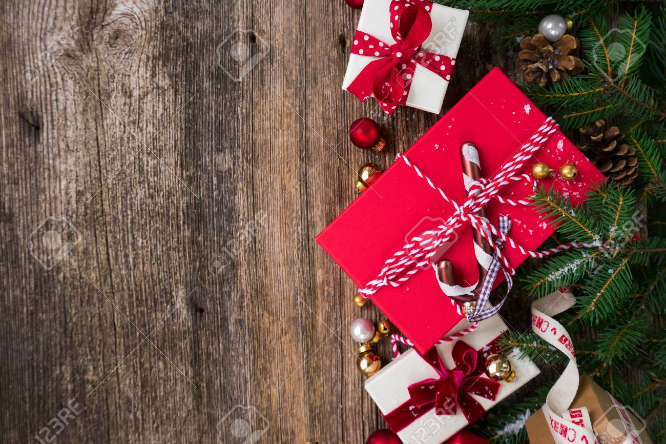 Christmas Gift Giving Images.Christmas Gift Giving Concept Christmas Presents In Red Paper