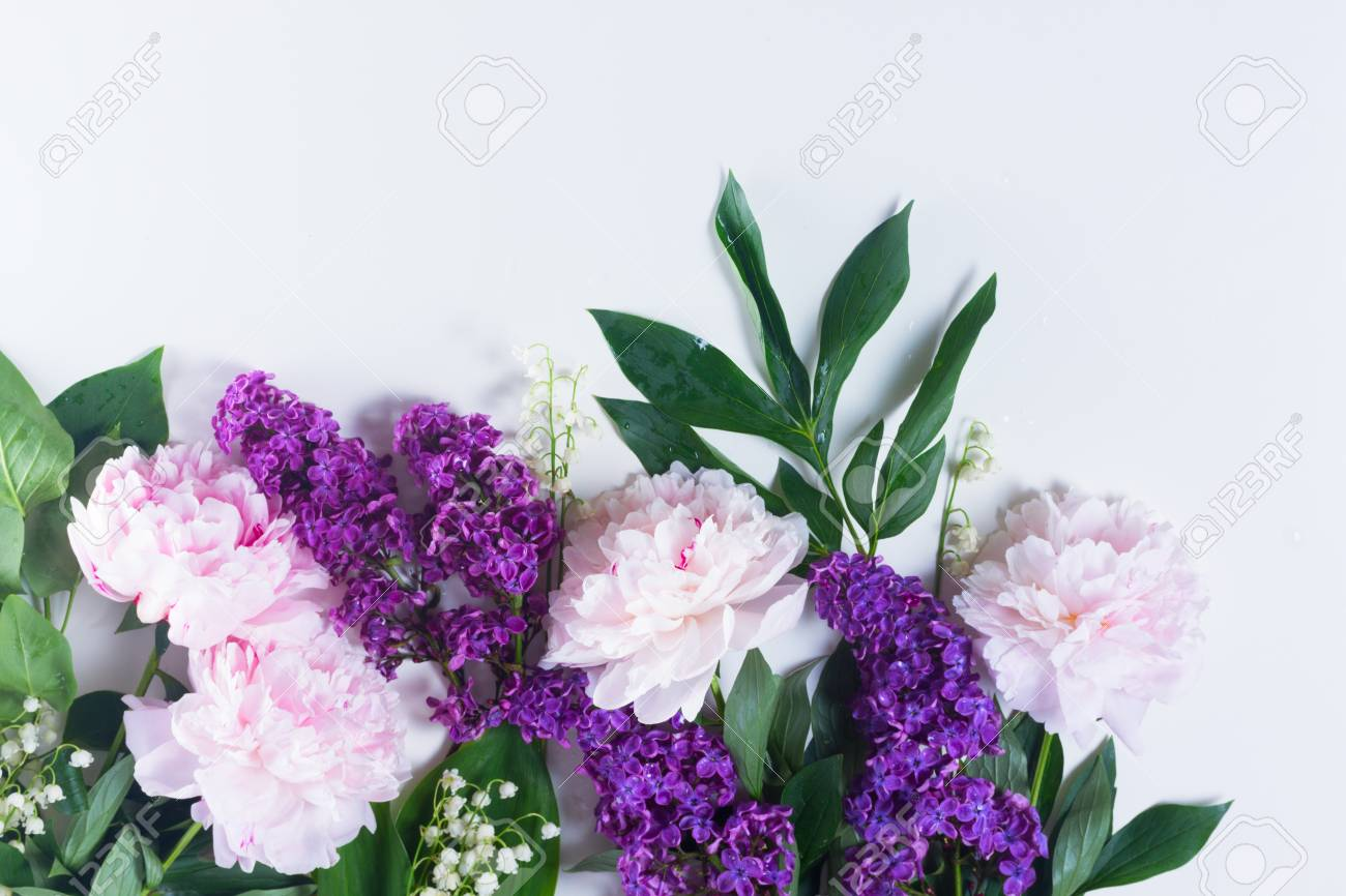 Floral flat lay scene of fresh spring flowers lilac peonies floral flat lay scene of fresh spring flowers lilac peonies and lilly of the mightylinksfo