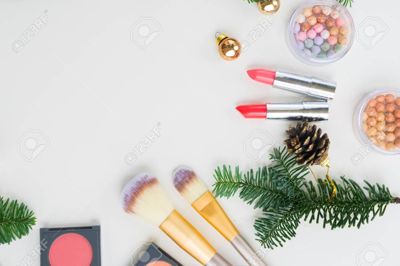 Set of Christmas make up cosmetics products with evergreen tree..