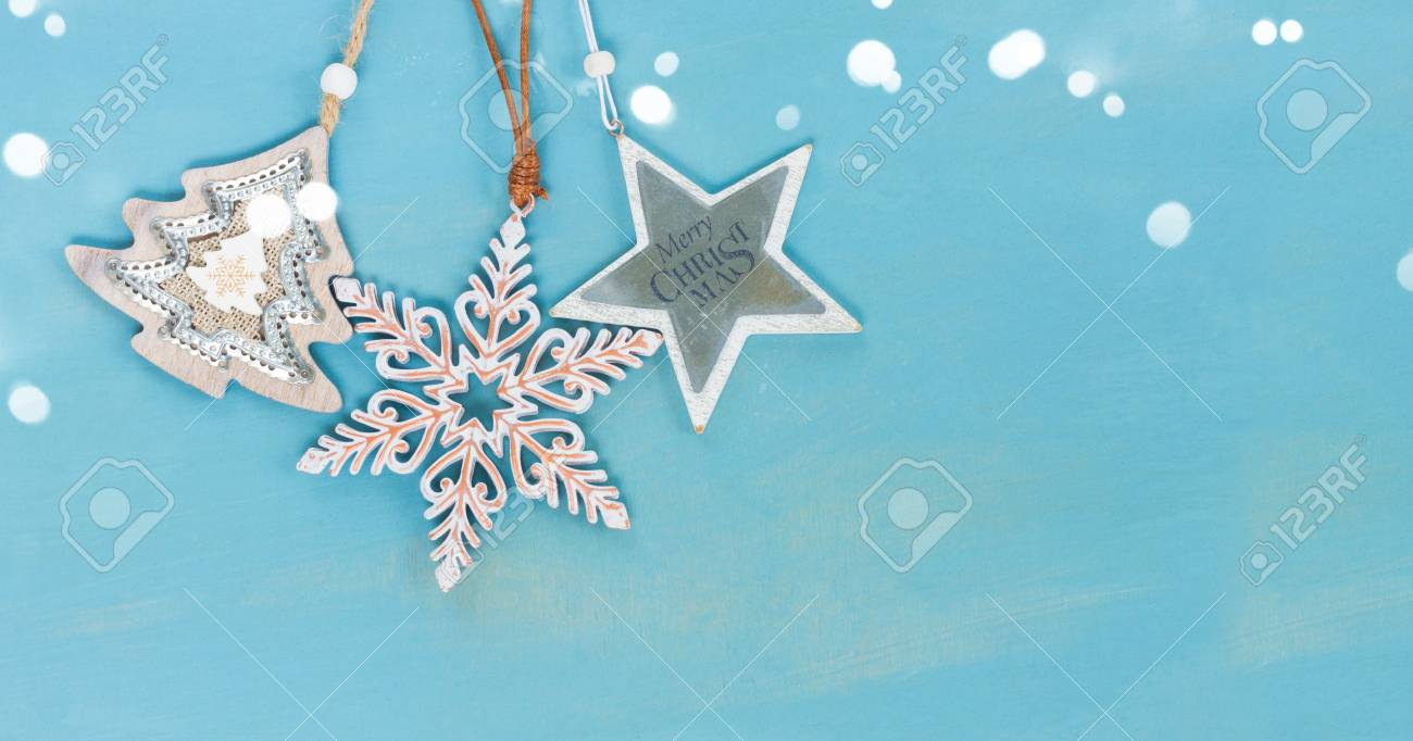 Blue And White Christmas Tree With Stars Hanging On Blue Wooden