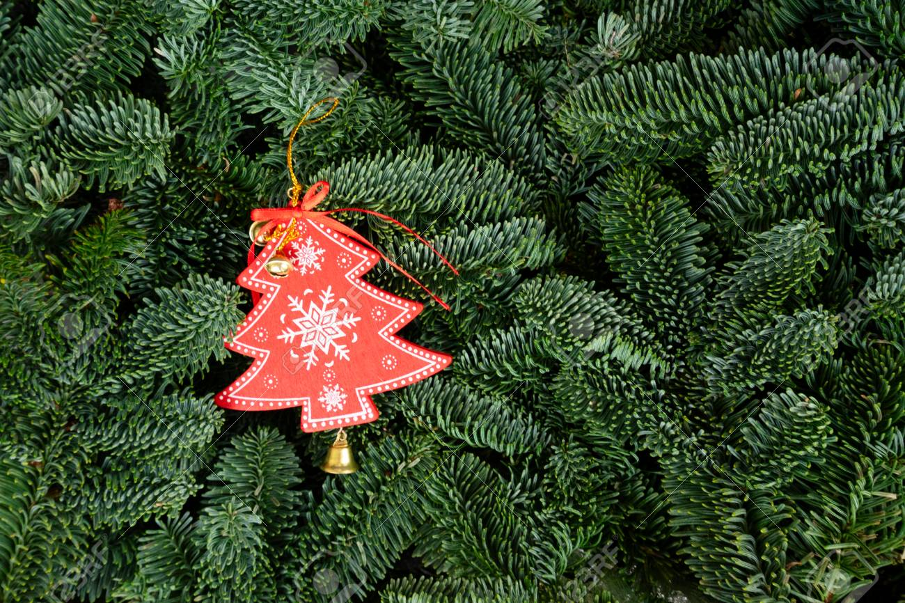 Christmas Background With Fresh Evergreen Tree Banches And Red Christmas Tree Decoration