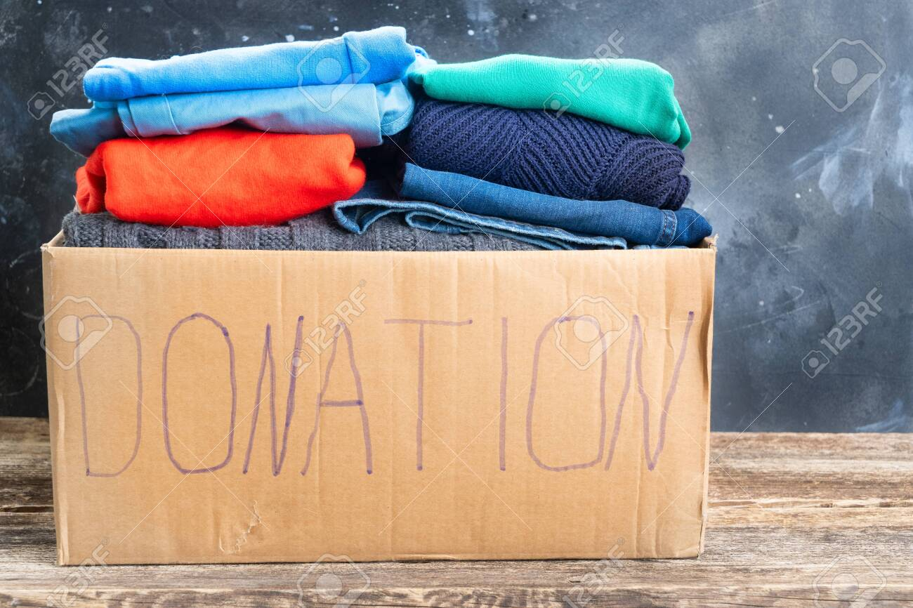 Donate Box With Clothes Donation And Charity Concept Stock Photo Picture And Royalty Free Image Image 127120607