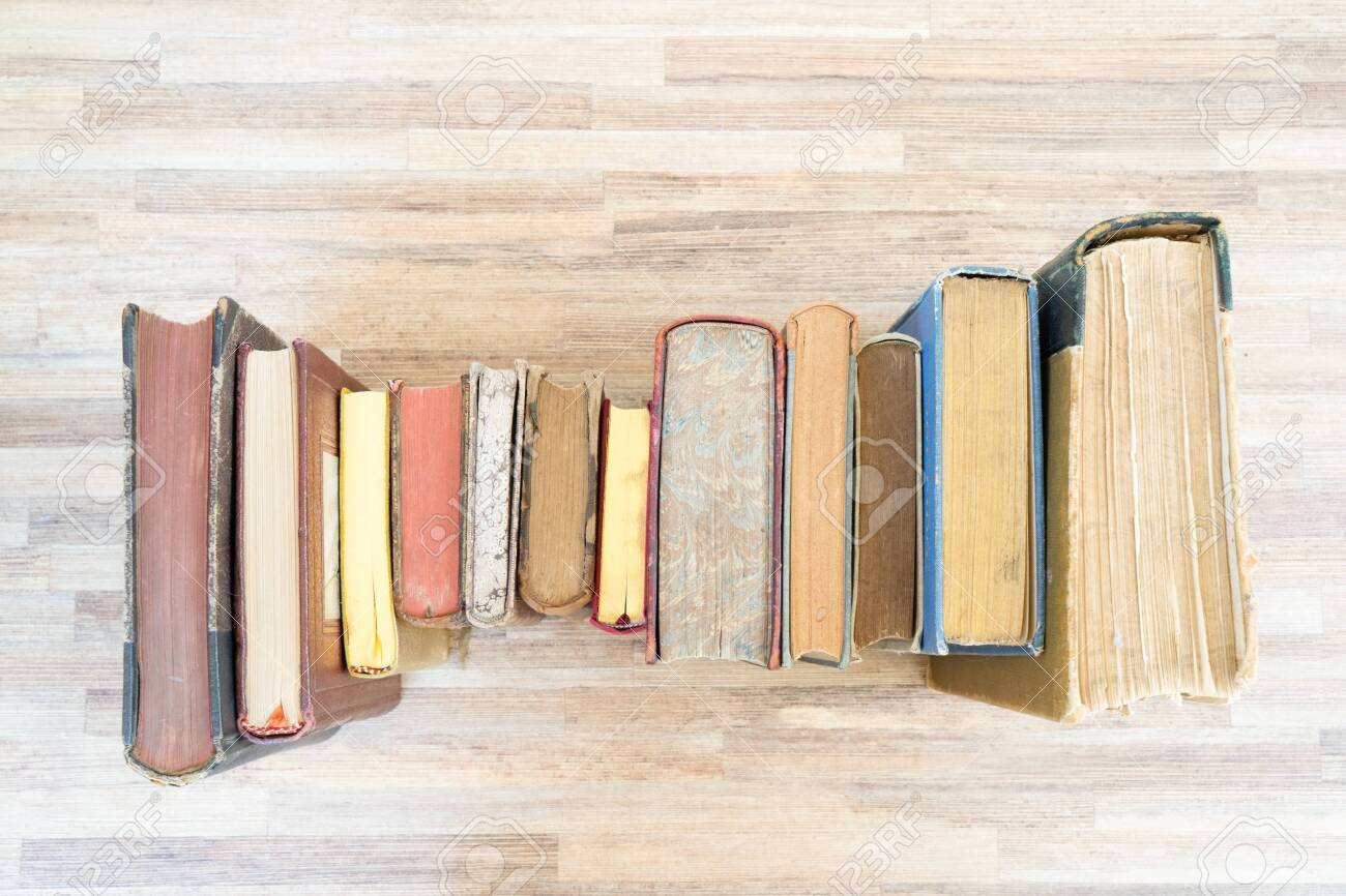 Old Books Row On Wooden Table Top View Flat Lay On Woden Table Stock Photo Picture And Royalty Free Image Image 128450296