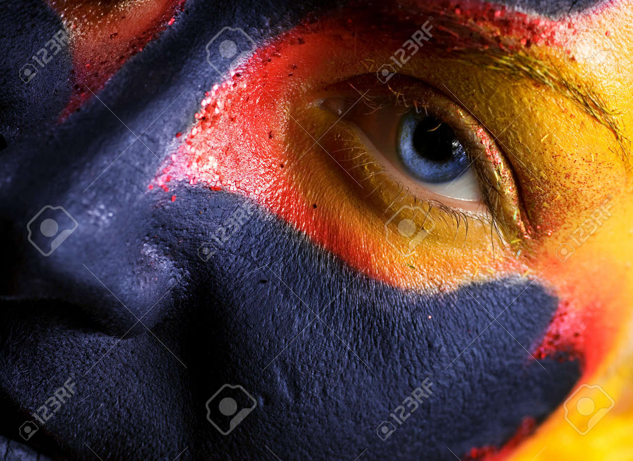 Portrait of a mysterious woman with artistic make-up on her face. Isolated on black background Stock Photo - 2202333