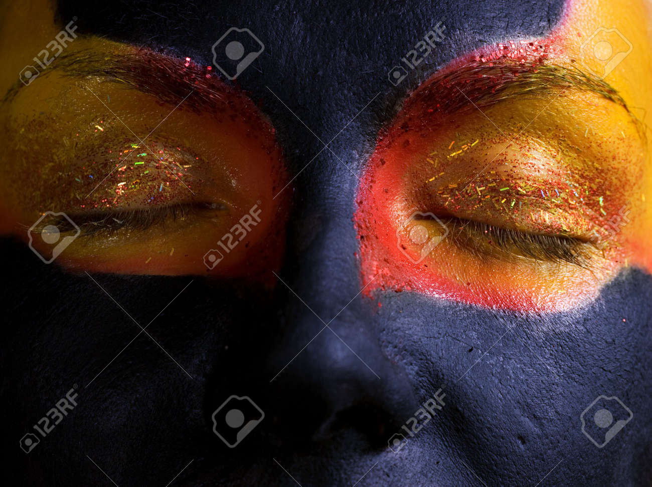 Portrait of a mysterious woman with artistic make-up on her face. Isolated on black background Stock Photo - 2202337