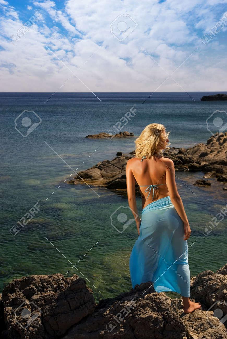 Beautiful girl relaxing near the sea Stock Photo - 2241382