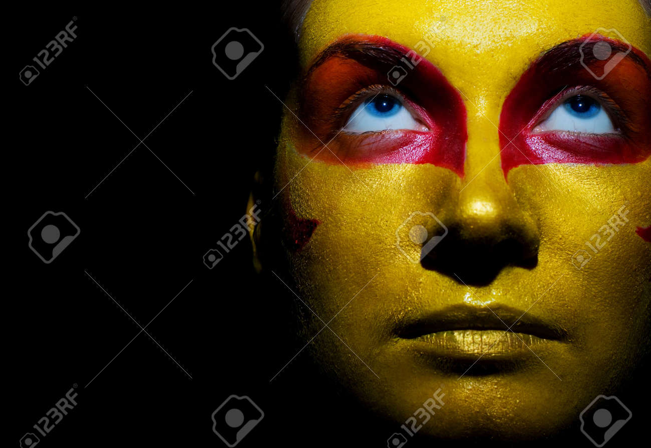 Portrait of a mysterious woman with artistic make-up on her face. Isolated on black background Stock Photo - 2262072