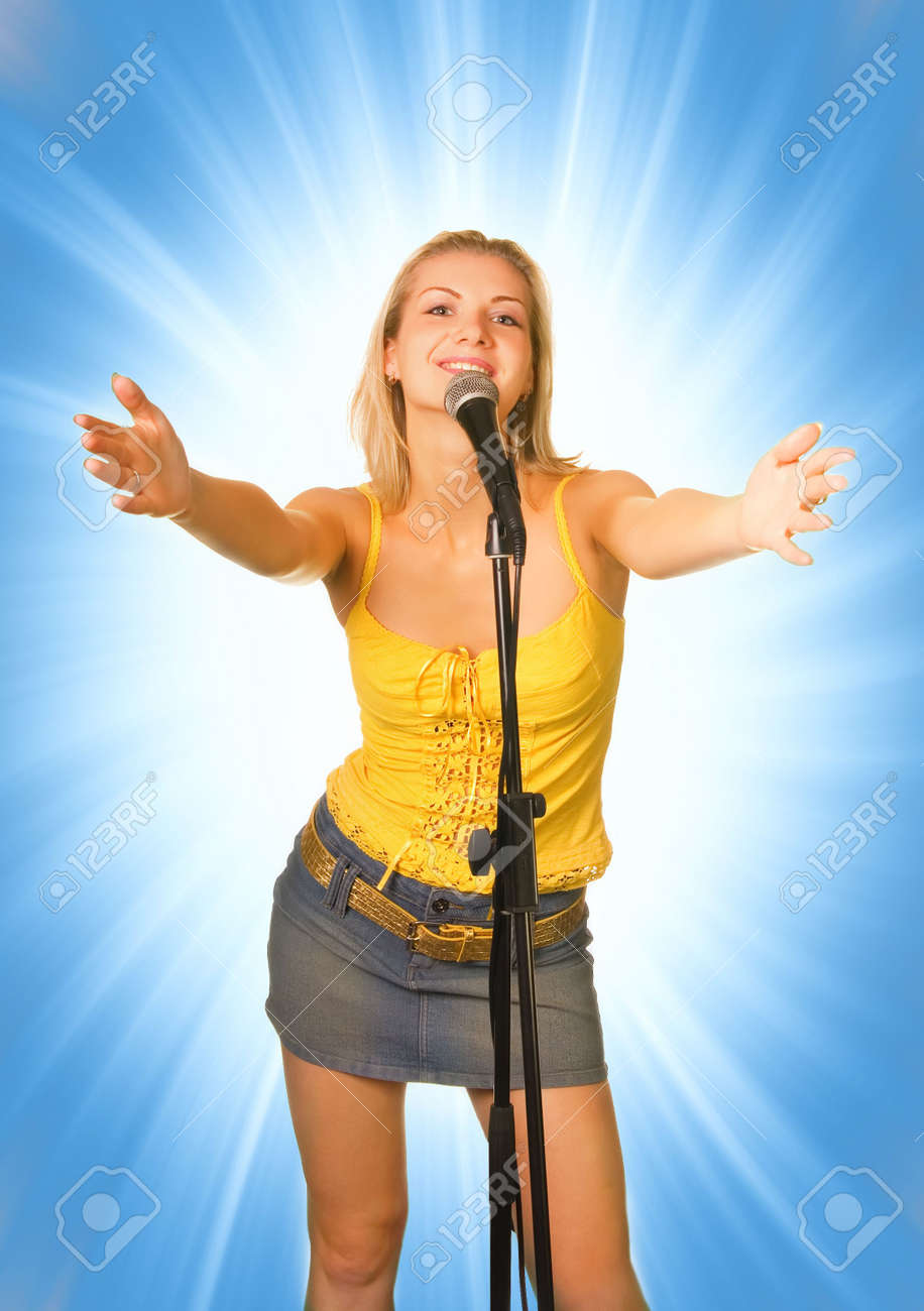 Singing young girl on abstract blue background Stock Photo - 2339127