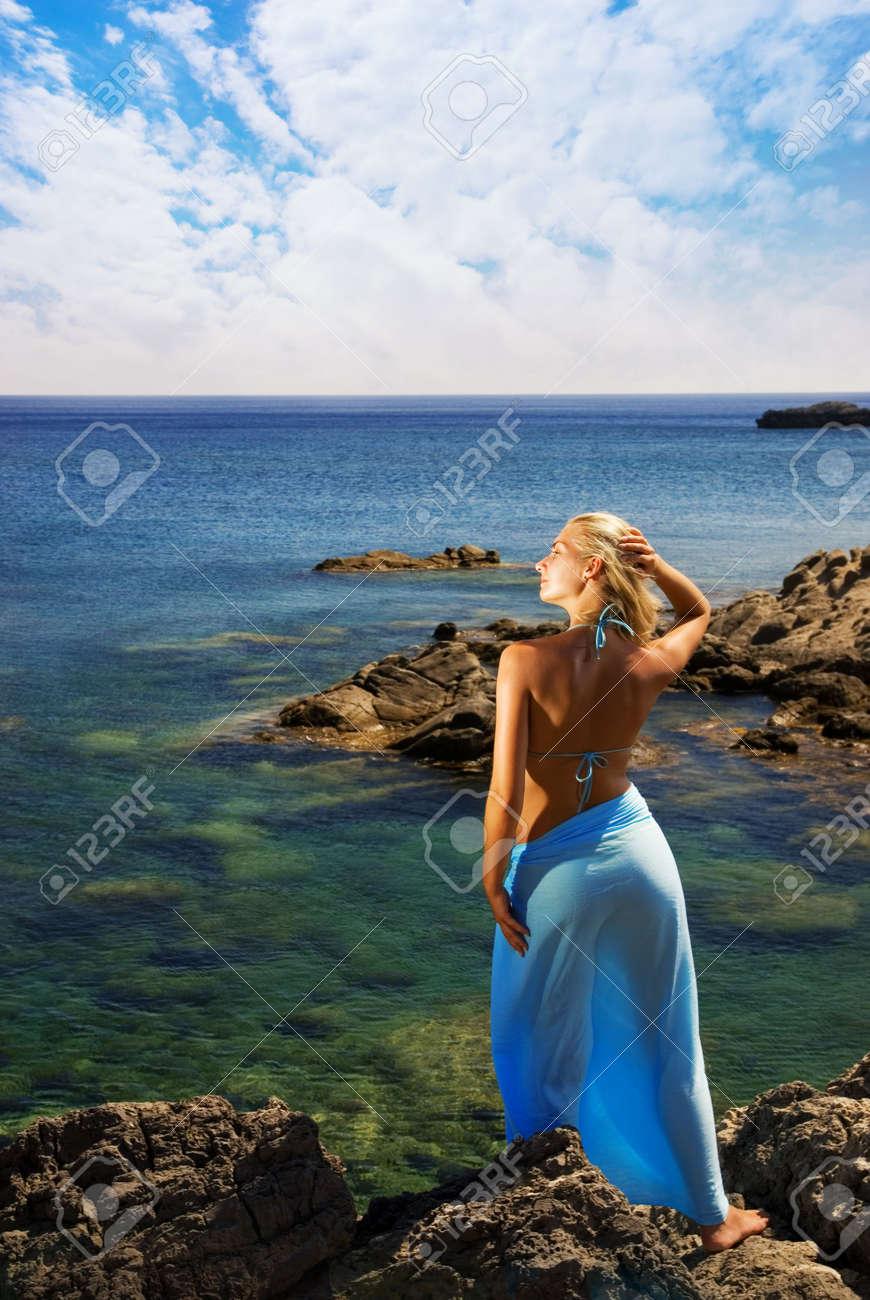 Beautiful girl relaxing near the sea Stock Photo - 2389368