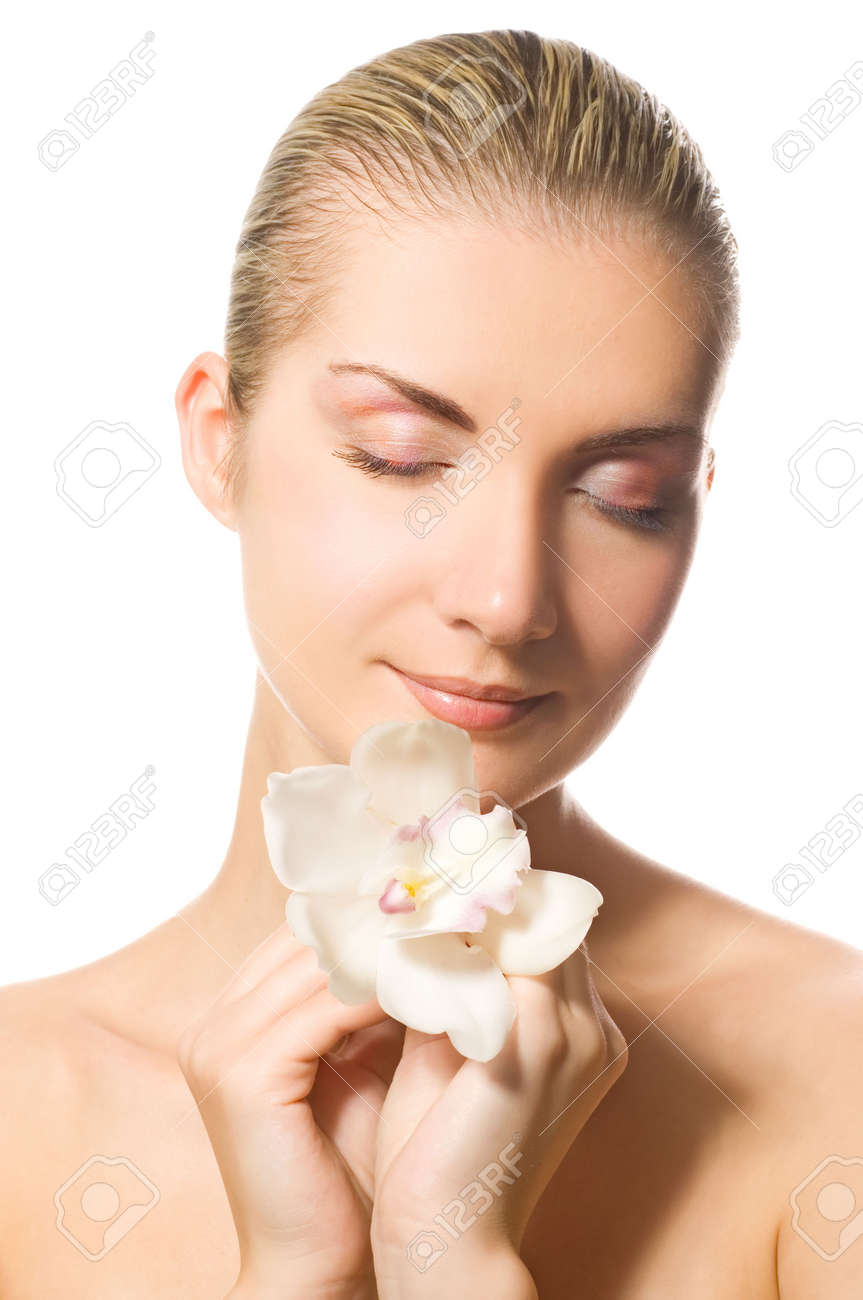 Beautiful girl holding orchid flower in her hands Stock Photo - 2470811