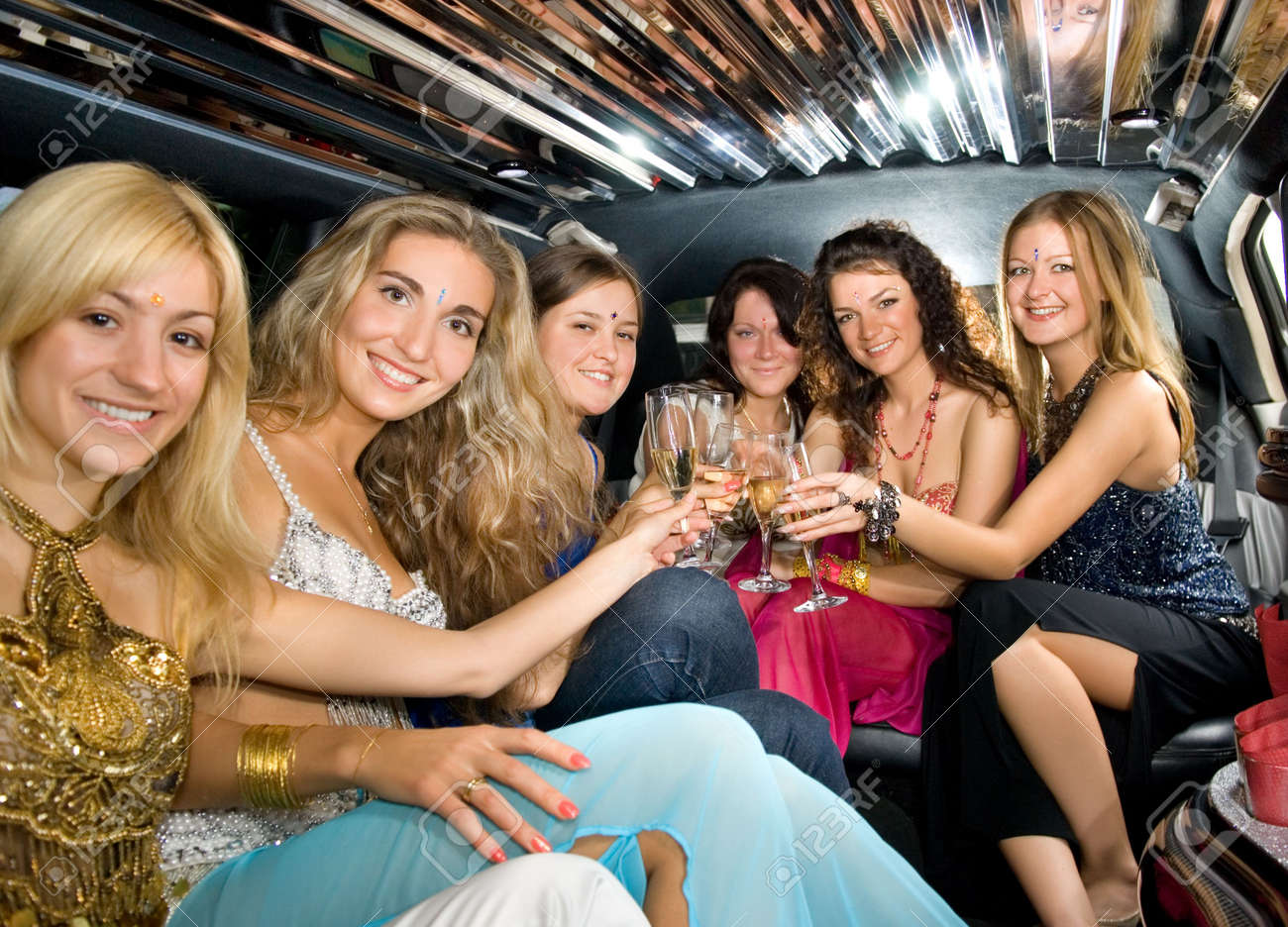 Group of beautiful women clinking glasses with champgagne inside a limousine Stock Photo - 3246666