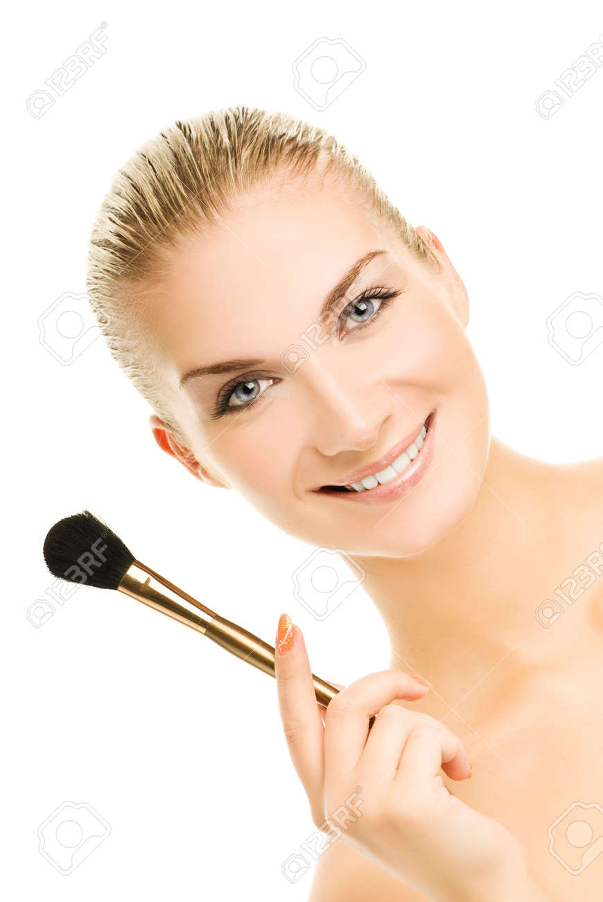 Lovely young woman with a make-up brush. Isolated on white background Stock Photo - 3336549