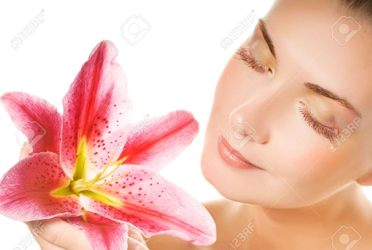 Beautiful young woman with pink lily close-up portrait. Isolated on white background Stock Photo - 3422146