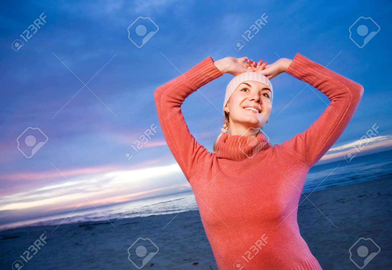 Beautiful young woman relaxing on a beach at evening Stock Photo - 3623124