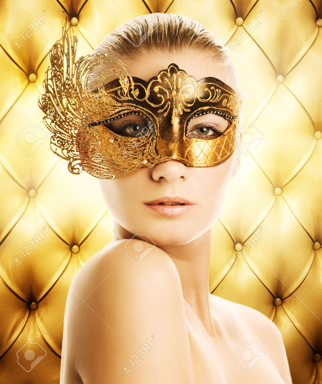 Beautiful woman in carnival mask over abstract background Stock Photo - 3942115
